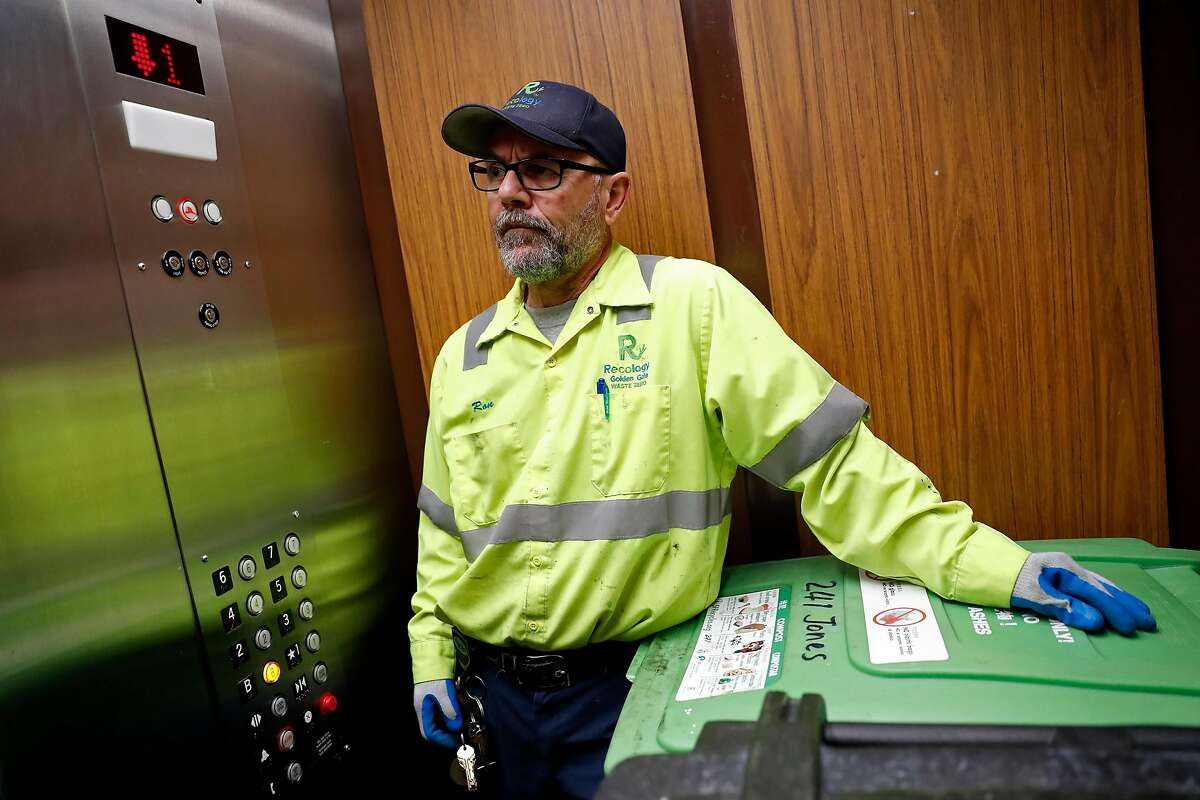 Recology's Ron Reali takes the elevator to to the Padre Apartments' basement while collecting garbage on Jones Street in Tenderloin District in San Francisco, Calif., on Tuesday, December 3, 2019.