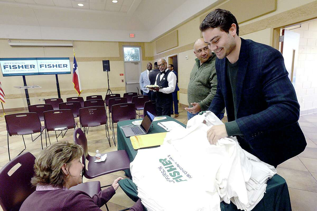 Joseph Trahan talks with Carla Smith as he picks out a t-shirt while attending Jefferson Fisher's event announcing his upcoming election bid to run for the Ward 2 Beaumont city council seat currently occupied by Mike Getz at Rogers Park Community Center Thursday. Photo taken Thursday, January 24, 2019 Photo by Kim Brent/The Enterprise