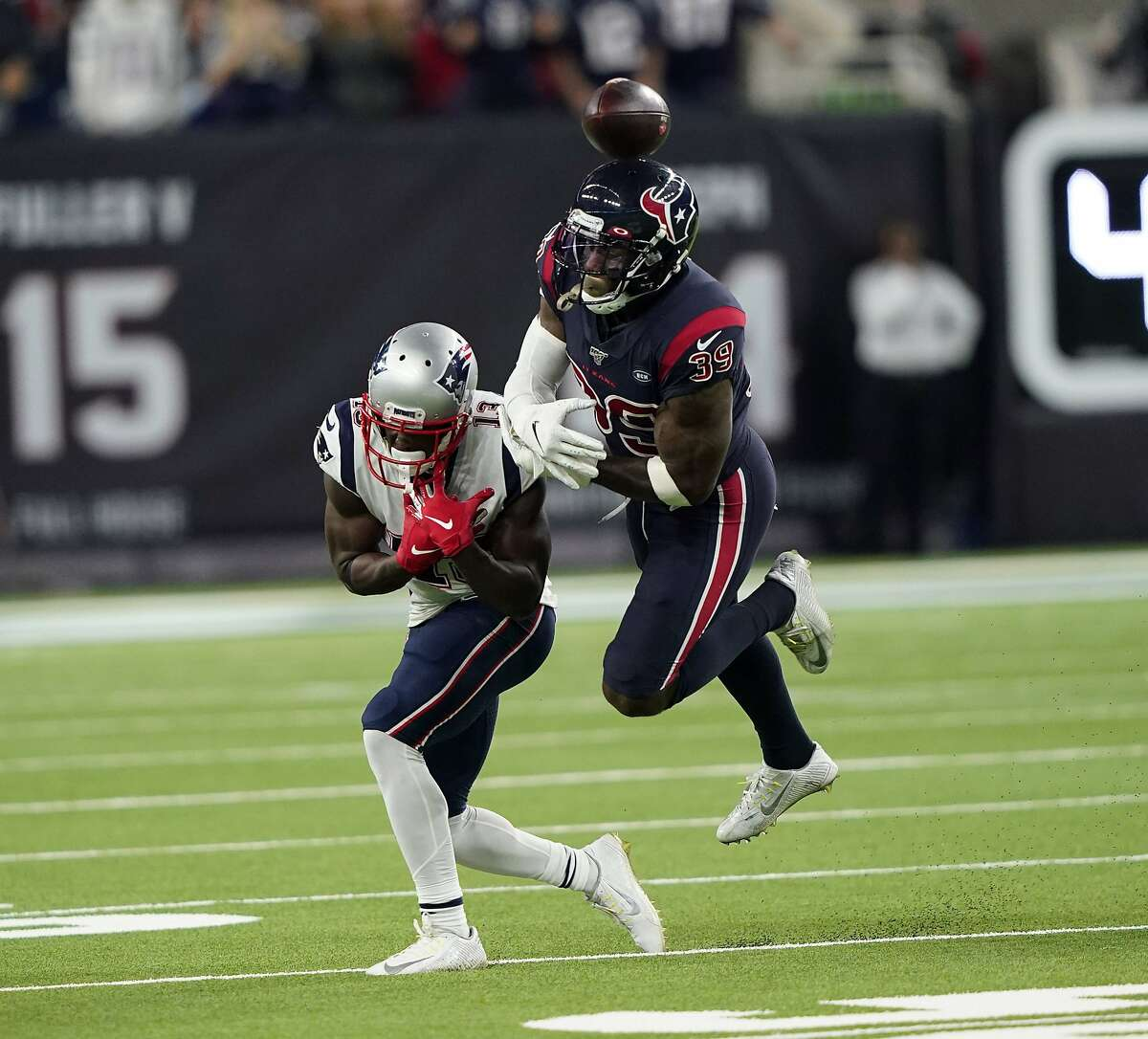 Houston Texans free safety Tashaun Gipson breaks up a pass intended for New England Patriots wide receiver Phillip Dorsett (13) during the second half of an NFL football game Sunday, Dec. 1, 2019, in Houston. (AP Photo/David J. Phillip)