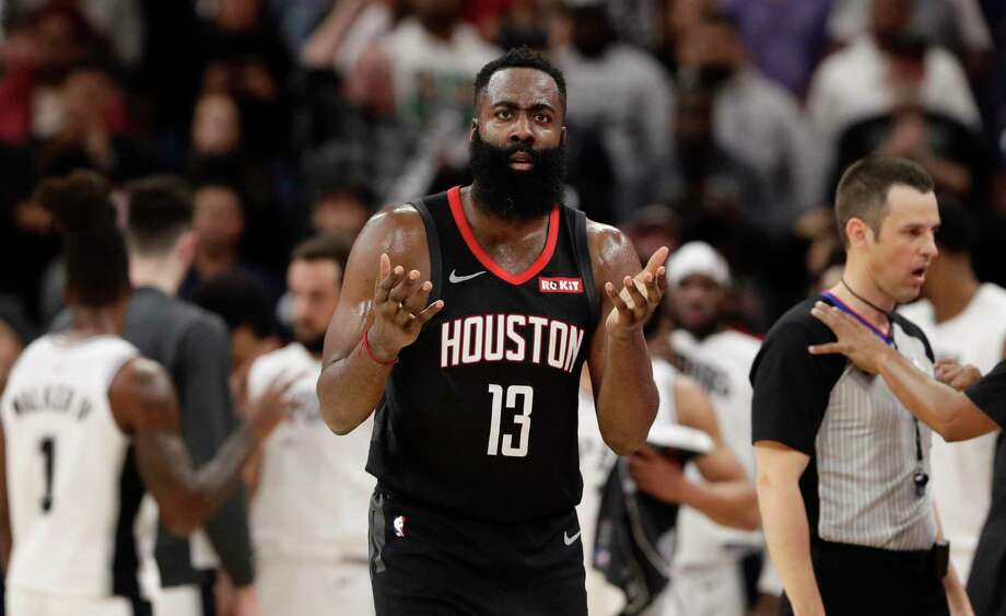 Houston Rockets guard James Harden (13) questions a call during the second half of an NBA basketball game against the San Antonio Spurs, in San Antonio, Tuesday, Dec. 3, 2019. San Antonio won 135-133 in double overtime. (AP Photo/Eric Gay) Photo: Eric Gay, STF / Associated Press / Copyright 2019 The Associated Press. All rights reserved.