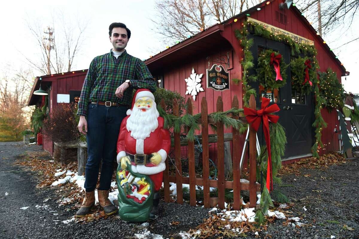 Tyler Newkirk, owner of Tyler Newkirk Craft Co., is photographed outside of his Christmas gift shop at B & B Farms in West Haven.