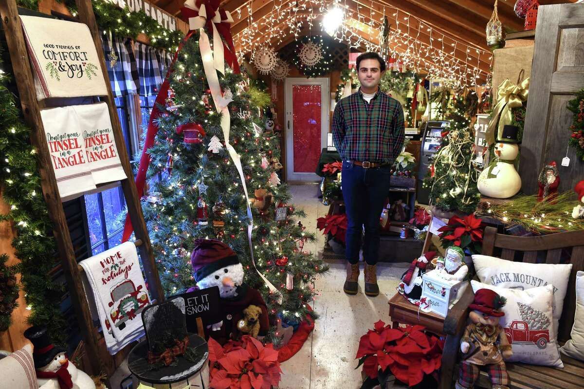 Tyler Newkirk, owner of Tyler Newkirk Craft Co., is photographed in his Christmas gift shop at B & B Farms in West Haven.