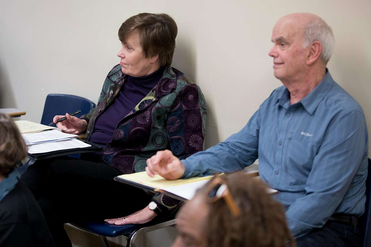 Lea Ann Fleming and Mike Fleming listen to a lecture during a Theater Elements and Interpretation class held at the City College of San Francisco Downtown Campus in San Francisco, Calif. Thursday, Dec. 6, 2019.