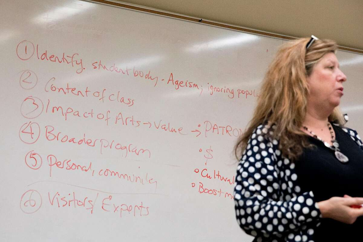 Notes on how to save their course are written on a whiteboard as instructor Patricia Miller speaks during a Theater Elements and Interpretation class held at the City College of San Francisco Downtown Campus in San Francisco, Calif. Thursday, Dec. 6, 2019.