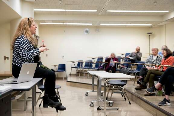 Instructor Patricia Miller speaks to students during a Theater Elements and Interpretation class held at the City College of San Francisco Downtown Campus in San Francisco, Calif. Thursday, Dec. 6, 2019.