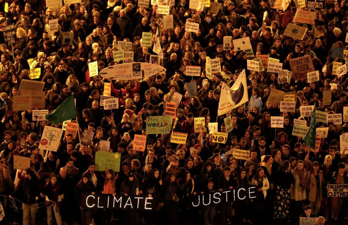Demonstrators march to demand world leaders take real action against climate change, during a protest in Madrid on Friday Dec. 6, 2019. (AP Photo/Bernat Armangue)
