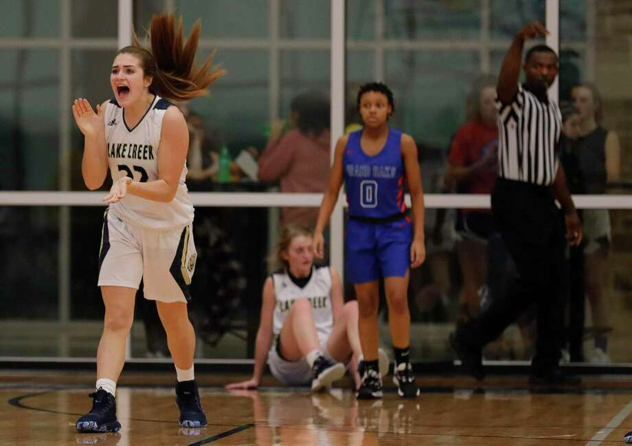 Lake Creek forward Sage Marcos (22) reacts after shooting guard Makenzie Logeman (1) hits a buzzer beating shot to end the first quarter of a District 20-5A high school girls basketball game at Lake Creek High School, Friday, Dec. 6, 2019, in Montgomery. Photo: Jason Fochtman, Houston Chronicle / Staff Photographer / Houston Chronicle