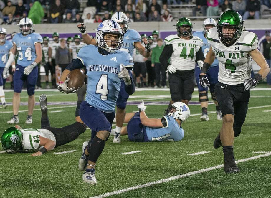 Greenwood's Trey Cross races outside and around Iowa Park's Cirby Coheley and the rest of the defense for a touchdown 12/06/19 at Anthony Field on the campus of Abilene Christian University. Tim Fischer/Reporter-Telegram Photo: Tim Fischer/Midland Reporter-Telegram