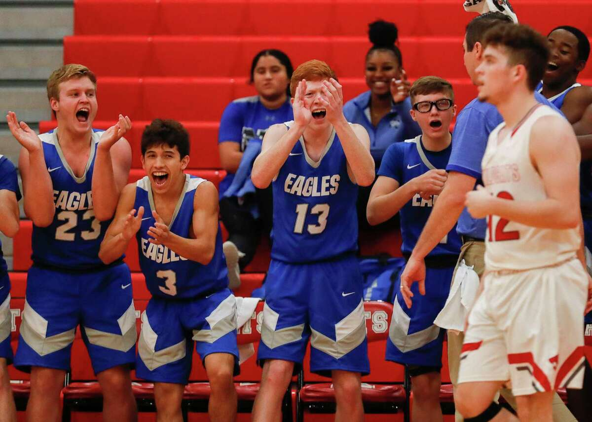 The New Caney bench reacts after a Splendora turnover during the third quarter of a high school basketball game in the Splendora Invitational at Splendora High School, Friday, Dec. 6, 2019, in Splendora.