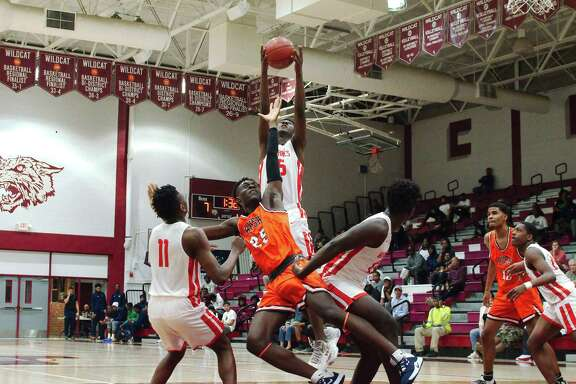 Clear Brook's Tosh Lyons (35) pulls down a rebound over Fort Bend Bush's T.J. Olaniyan (25) Friday during the Carlisle-Krueger Classic basketball tournament at Clear Creek High School.
