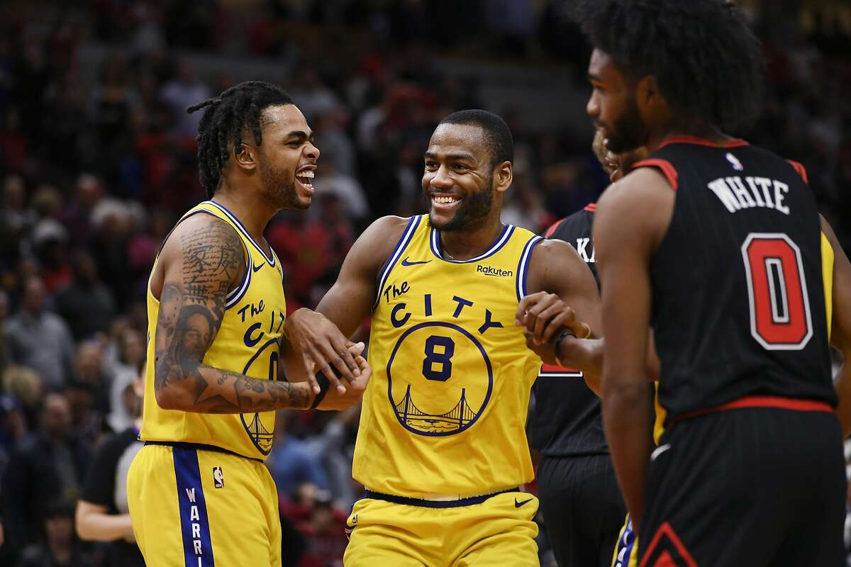 Golden State Warriors' Alec Burks (8) and D'Angelo Russell (0) celebrate after the Warriors defeated the Chicago Bulls 100-98 in an NBA basketball game Friday, Dec. 6, 2019, in Chicago.