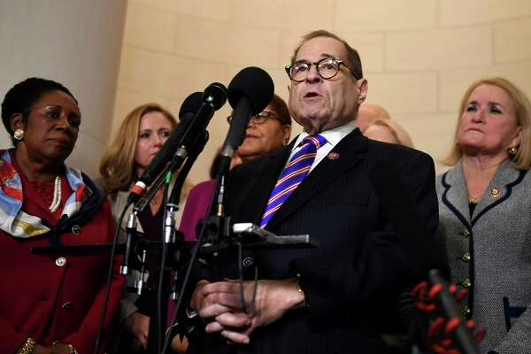 House Judiciary Committee Chairman Jerrold Nadler, D-N.Y., standing with other committee Democrats, talks to reporters following the House Judiciary Committee hearing on Capitol Hill in Washington, Wednesday, Dec. 4, 2019, on the on the constitutional grounds for the impeachment of President Donald Trump. (AP Photo/Susan Walsh)