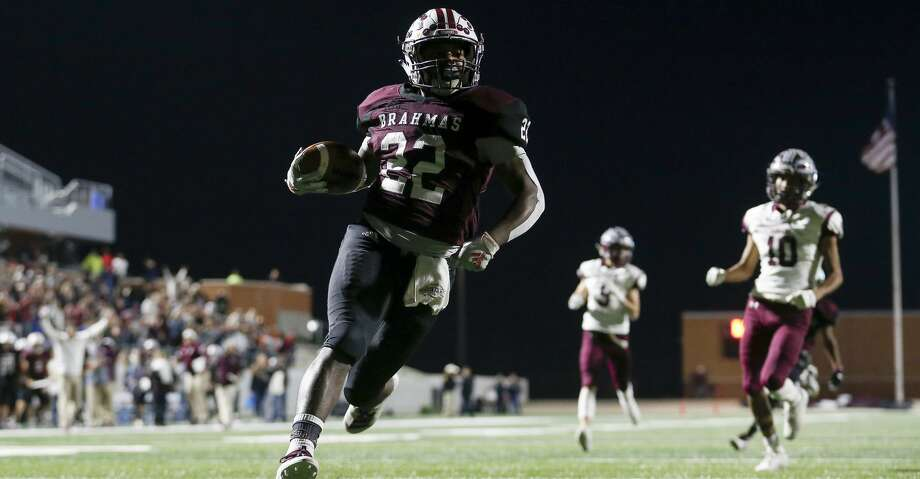 East Bernard Brahmas Devin Chapman (22) rushes for a touchdown during the first half of the high school football playoff game between the East Bernard Brahmas and the Ganado Indians at Freedom Field in Rosharon, TX on Friday, December 6, 2019. The Brahmas lead the Indians 30-10 at halftime. Photo: Tim Warner/Contributor