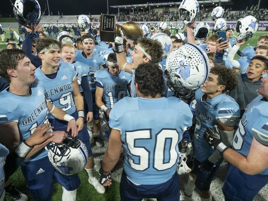 Greenwood players celebrate a 36-33 win over Iowa Park in the Class 4A Division II state quarterfinal 12/06/19 at Anthony Field on the campus of Abilene Christian University. Tim Fischer/Reporter-Telegram Photo: Tim Fischer/Midland Reporter-Telegram