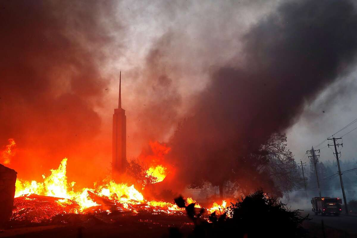 The Church of Jesus Christ of Latter Day Saints burns during Camp Fire in Paradise, Calif.. on Thursday, November 8, 2018.