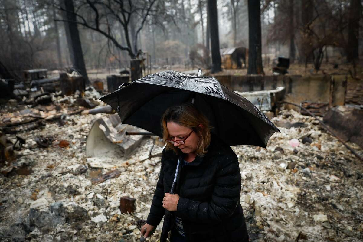 Suzanne Kaksonen looks through her property for the first time after the Camp Fire tore through the area on Wee Dell Road in Paradise, California, on Sunday, Dec. 16, 2018.