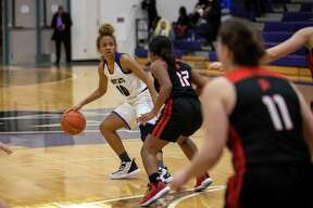 Willis' Jasmine Kelly, guard, dribbles at the top of the key in District 20-5A game against Porter at Willis High School, Friday, Dec. 6, 2019.