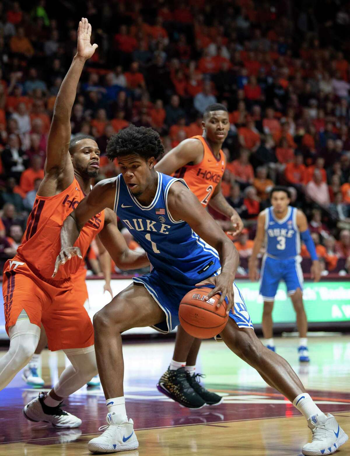Duke center Vernon Carey Jr. (1) drives against Virginia Tech forward P.J. Horne, left, during the first half of an NCAA college basketball game Friday, Dec. 6, 2019, in Blacksburg, Va. (AP Photo/Don Petersen)