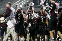 East Bernard Brahmas Kameron Matthews (9) celebrates with teammates after the high school football playoff game between the East Bernard Brahmas and the Ganado Indians at Freedom Field in Rosharon, TX on Friday, December 6, 2019. The Brahmas defeated the Indians 30-10.