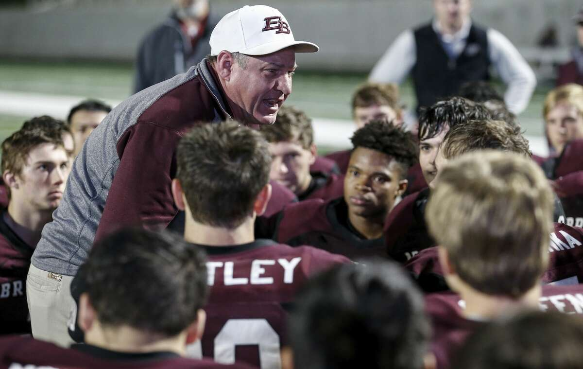 East Bernard Brahmas head coach Wade Bosse talks to the team after the high school football playoff game between the East Bernard Brahmas and the Ganado Indians at Freedom Field in Rosharon, TX on Friday, December 6, 2019. The Brahmas defeated the Indians 30-10.