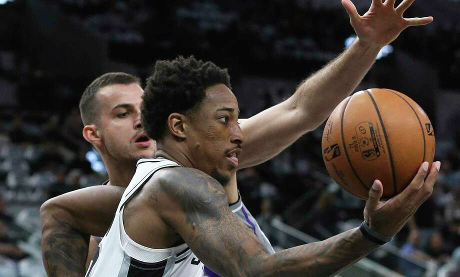 DEMar DeRozan looks for a passing outlet after driving past Nemanja Bjelica as the Spurs host the Kings at the AT&T Center on Dec. 6, 2019. Photo: Tom Reel, San Antonio Express-News / Staff Photographer / **MANDATORY CREDIT FOR PHOTOG AND  SAN ANTONIO EXPRESS-NEWS/NO SALES/MAGS OUT/TV