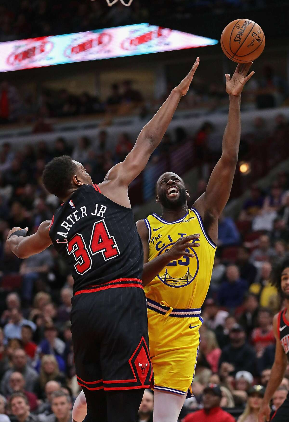 Draymond Green #23 of the Golden State Warriors shoots against Wendell Carter Jr. #34 of the Chicago Bulls at United Center on December 06, 2019 in Chicago, Illinois. The Warriors defeated the Bulls 100-98. NOTE TO USER: User expressly acknowledges and agrees that , by downloading and or using this photograph, User is consenting to the terms and conditions of the Getty Images License Agreement.