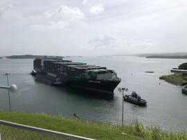 The container ship Ever Lotus traverses the new locks in the Panama Canal.