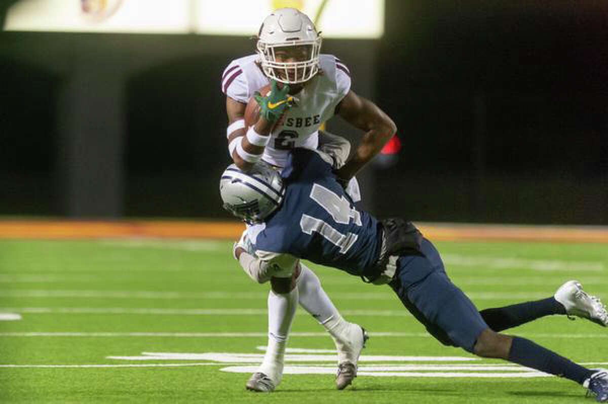 Silsbee senior Chris Martin (2) runs the ball upfield and is taken down by West Orange-Stark junior Artavious Samuel (14) in the first half of their quarterfinal match on Friday night at BISD Memorial Stadium. Fran Ruchalski/The Enterprise