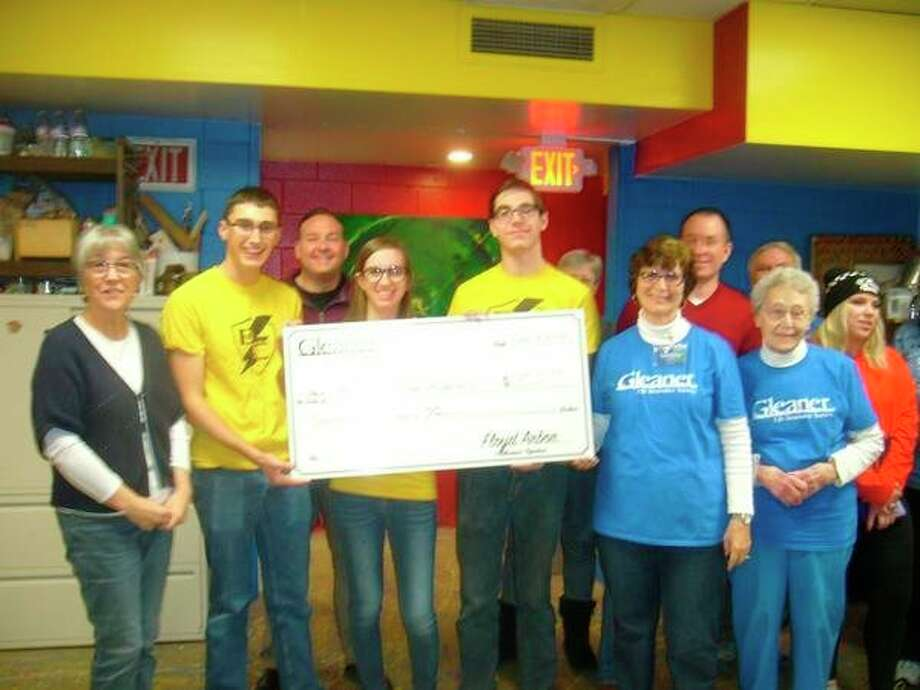 Floyd Arbor 206 of the Gleaner Life Insurance Society recently presented a check for $750 to the Bullock Creek Robotics team.(Photo provided)