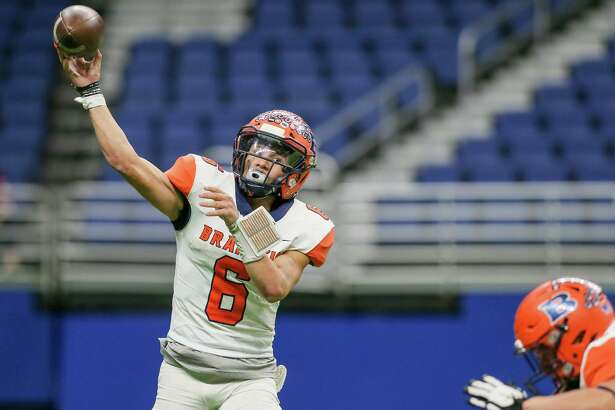Brandeis quarterback Jordan Battles gets off a pass during the second half of their Class 6A Division II State Quarterfinal high school football game with Austin Westlake at the Alamodome on Friday, Dec. 6, 2019. Westlake beat Brandeis 42-14.