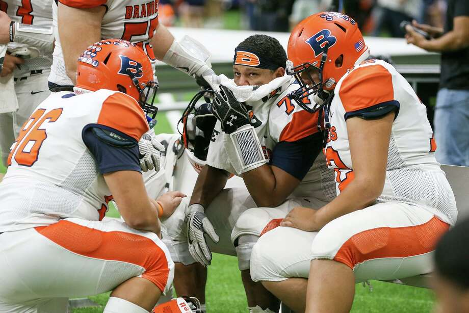 Brandeis linemen console each other at the conclusion of their Class 6A Division II State Quarterfinal high school football game with Austin Westlake at the Alamodome on Friday, Dec. 6, 2019. Westlake beat Brandeis 42-14. Photo: Marvin Pfeiffer, San Antonio Express-News / Staff Photographer / **MANDATORY CREDIT FOR PHOTOG AND SAN ANTONIO EXPRESS-NEWS/NO SALES/MAGS OUT/TV