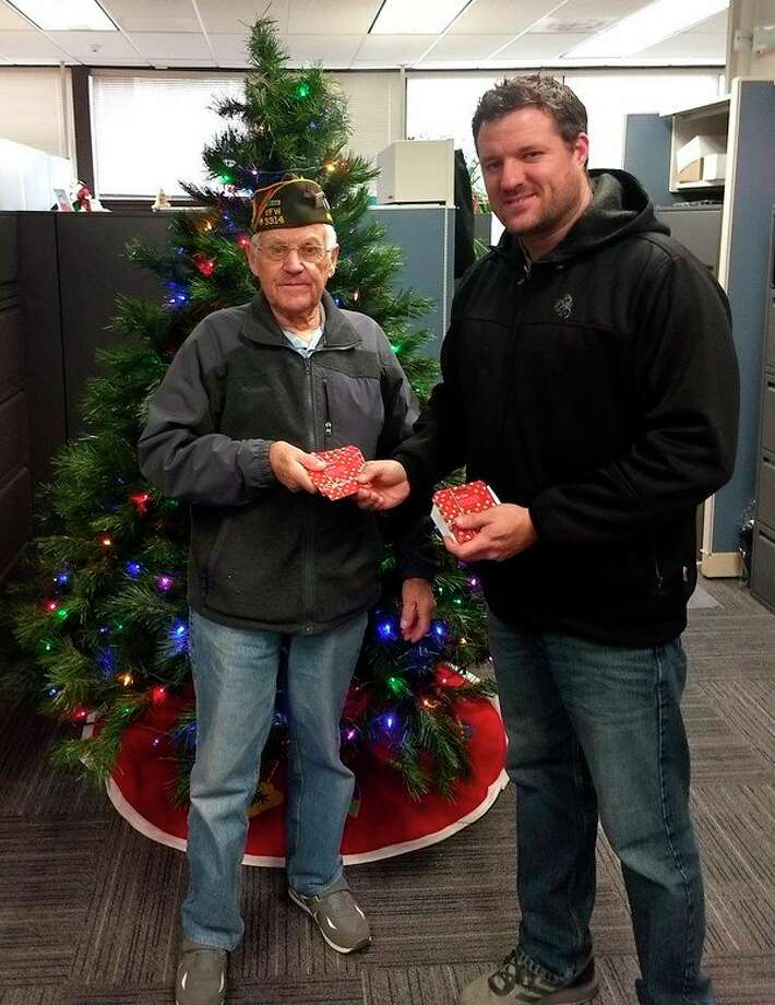 (From left) Arcadia VFW Post 3314 Quartermaster Keith McArthur presents a donation to Matthew Dotson, Community Resource Coordinator at Benzie-Manistee MDHHS. (Courtesy photo)