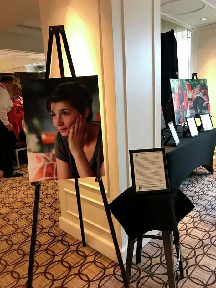In both photos, selections of photos from the Defining Hope photo exhibit were on display at Midland's Open Door Dine on the Doors fundraiser in November. (Photos provided)
