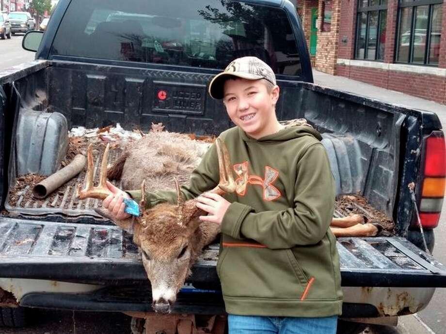 Logan Cassidy, 13, of Rodney, shot this 10-point buck with 18-inch rack span on Nov. 17 in Mecosta County. (Pioneer photo/John Raffel)
