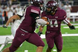Abernathy's Matthew DeAnda gets a block from Dante Flores on his interception return against Canadian during their Class 3A Division II Region 1 championship football game on Friday night in Buffalo Stadium at West Texas A&M University in Canyon.