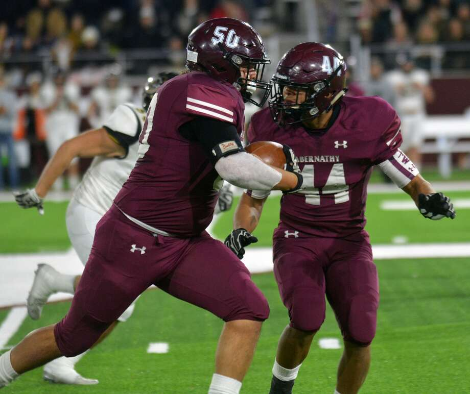 Abernathy's Matthew DeAnda gets a block from Dante Flores on his interception return against Canadian during their Class 3A Division II Region 1 championship football game on Friday night in Buffalo Stadium at West Texas A&M University in Canyon. Photo: Nathan Giese/Planview Herald