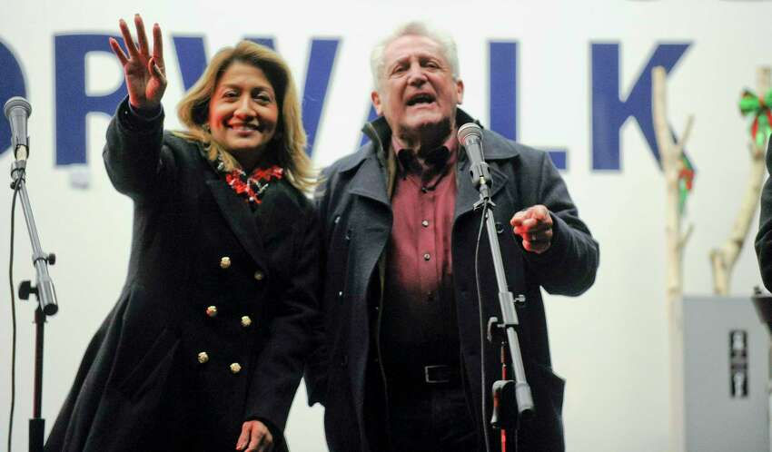 Norwalk's First Lady Lucia Rilling and her husband Mayor Harry Rilling sing holiday songs after the lighting of the annual Holiday Tree on the front lawn of City Hall in Norwalk, Conn. on Dec. 6, 2019.