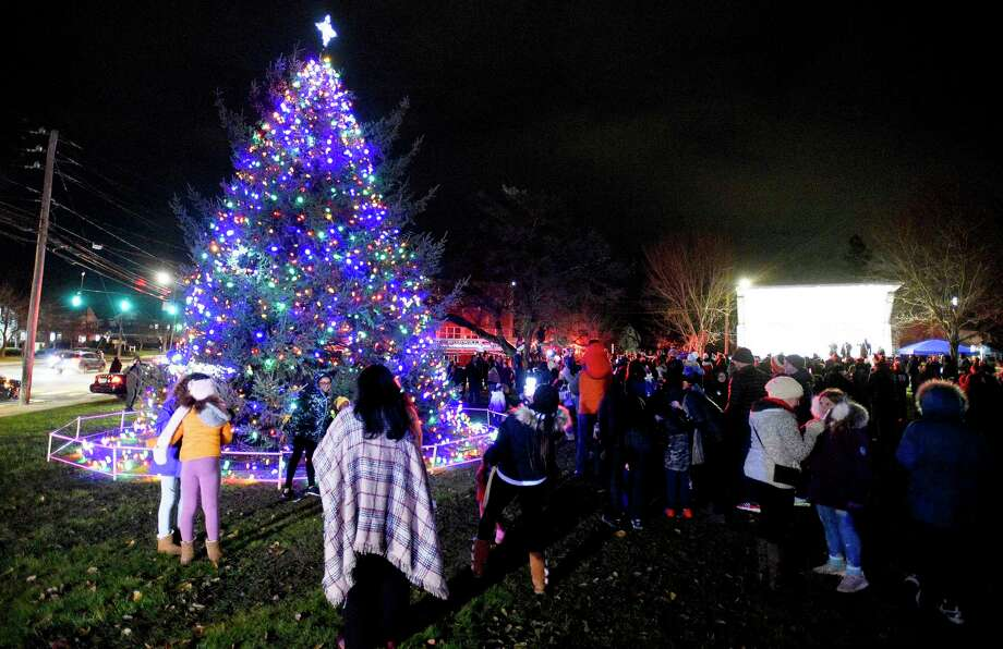 Residents snap photos infront of the Holiday Tree after it was lit on the front lawn of City Hall in Norwalk, Conn. on Dec. 6, 2019. Photo: Matthew Brown / Hearst Connecticut Media / Stamford Advocate
