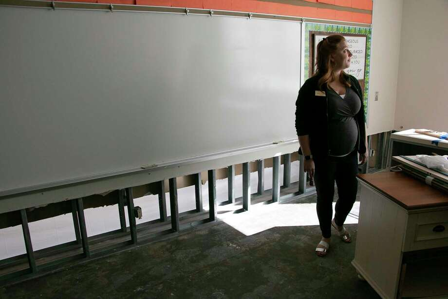 On May 7, St. Martha Catholic School flooded with four inches of water. About a month after they returned from the damage, Topical Storm Imelda flooded the building again with 6 inches of water. The destruction has left faculty and staff finding options for protecting their building against future flood risks. Principal Jessica Munscher looks at the sectioned off classrooms that were damaged from flooding on Sept. 16. Photo: Savannah Mehrtens/Staff Photo