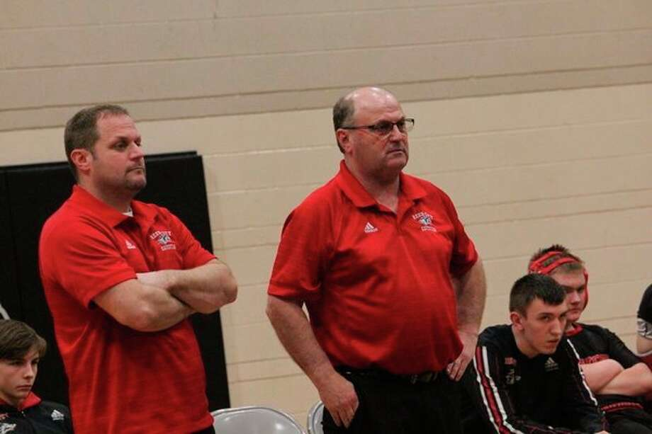Reed City coach Roger Steig (right) will open his wrestling season on Dec. 11. (Herald Review file photo)