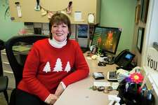 Janine Ouderkirk, executive director for Shelterhouse, poses for a portrait Friday in her office. (Katy Kildee/kkildee@mdn.net)