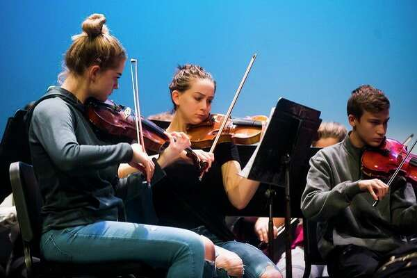 Musicians in the Midland High School orchestras rehearse Thursday for tonight's Rhapsody Rendezvous talent show at Midland Center for the Arts. (Katy Kildee/kkildee@mdn.net)