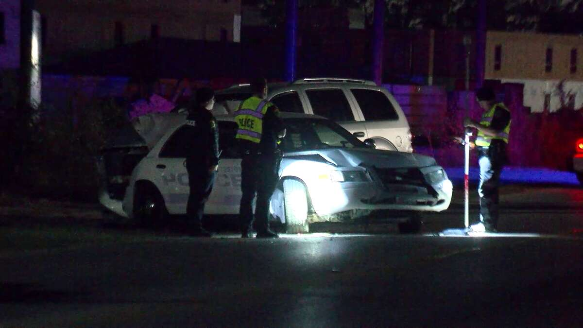 A Houston police officer was injured after a suspected drunk driver crashed into his police cruiser on Saturday morning.