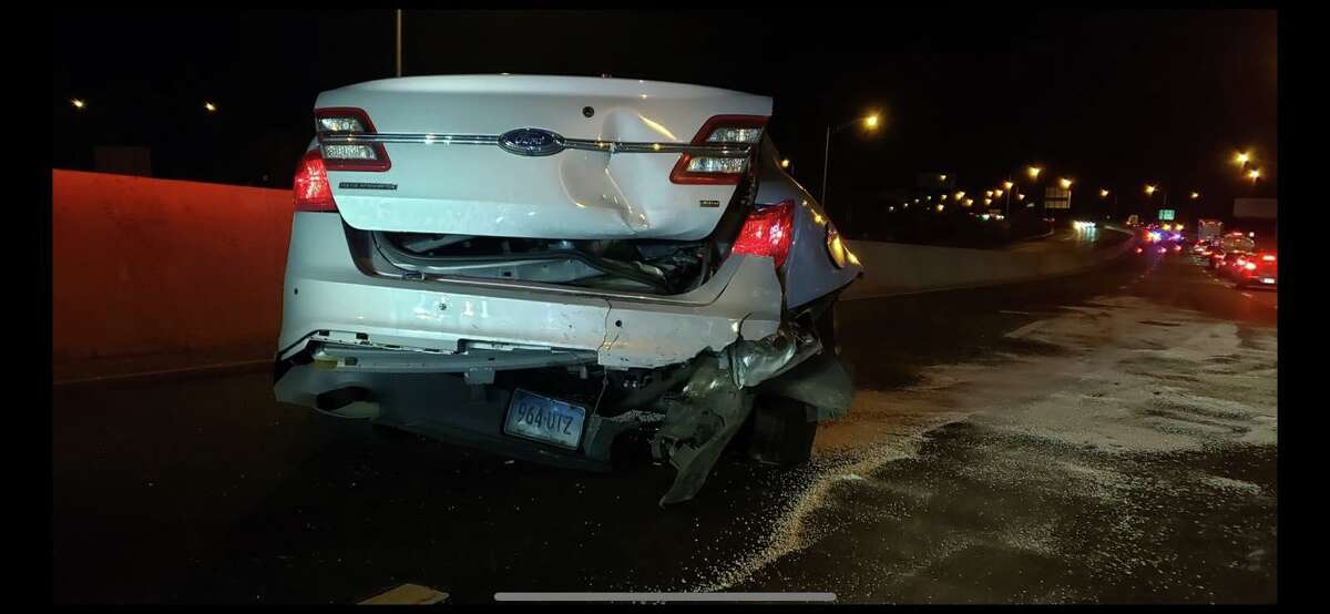 Photo from a collision on I-95 in Norwalk on Saturday in which a driver struck a police cruiser and a disabled vehicle with his Tesla, which he claimed was on autopilot, according to state police.