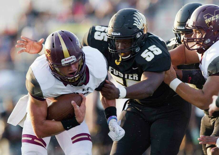 Foster tackle DeAundre Hicks (55) wraps up Magnolia West running back Hunter Bilbo (20) during the first quarter of a non-district high school football game at Guy K. Traylor Stadium, Saturday, Sept. 14, 2019, in Rosenberg. Photo: Jason Fochtman, Houston Chronicle / Staff Photographer / Houston Chronicle