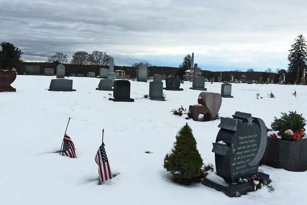 The Newtown Village Cemetery, where some of the victims of the Dec. 14, 2012 shooting are buried, on Thursday, Dec 7, 2019.