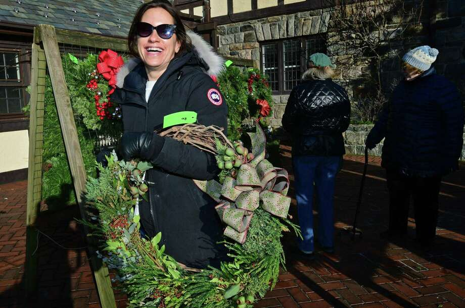 Local residents including Lisa Fry browse the showcase of holiday decorations during the Rowayton Gardeners' Annual Christmas Market December 7, 2019, at the Rowayton Community Center in Norwalk, Conn. The Market features designer-quality wreaths and center pieces, one-of-a-kind gifts, boxwood trees and ornaments. A range of fabulous items were on offer at the Silent Auction. The popular fundraising holiday event was sponsored by Fairfield County Bank and by supporting sponsor Rand Insurance. Photo: Erik Trautmann / Hearst Connecticut Media / Norwalk Hour