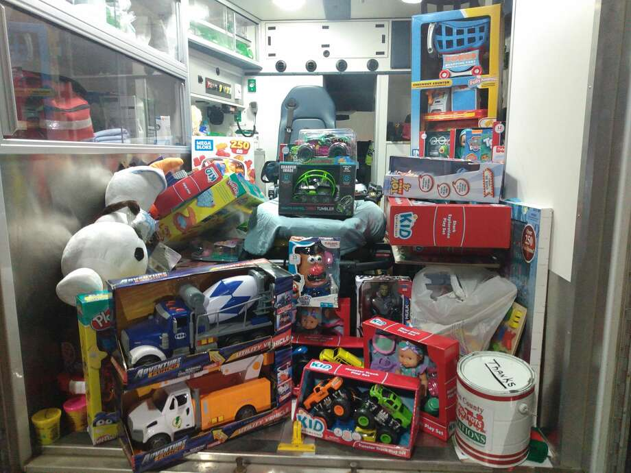 This ambulance is loaded with toys, thanks to Walmart shoppers. Photo: Sara Eisinger/Huron Daily Tribune