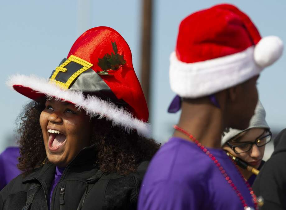 Willis berry saxaphone player Avari Ford shares a laugh as she wears a festive hat during Willis' annual Christmas parade, Saturday, Dec. 7, 2019, in Willis. Photo: Jason Fochtman/Staff Photographer