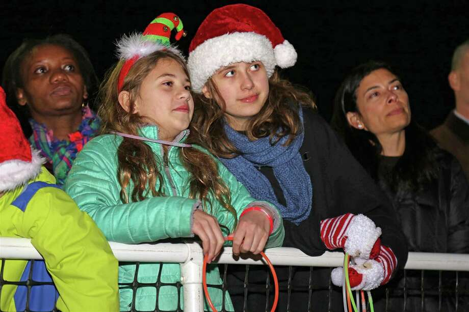 Hannah Lewis, 12, left, and Jaci Alley, 12, both of Fairfield, enjoy the singers at the annual tree lighting at Town Hall on Friday, Dec. 6, 2019, in Fairfield, Conn. Photo: Jarret Liotta / Jarret Liotta / ©Jarret Liotta